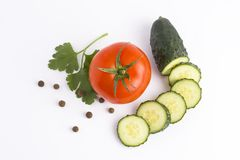 Red tomato garlic and cucumber on a white background Fresh vegetables on a white background. Cucumber and tomato on a white backgr Stock Photography