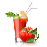 Red tomato and glass of juice on white Royalty Free Stock Image