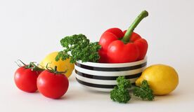 Red Tomato Green Broccoli Red Bell Pepper and Yellow Lime Stock Photos