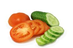Red tomato and  green cucumber chopped circles Stock Photography