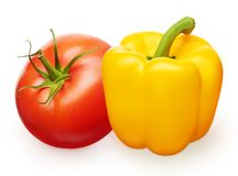 Red tomato with green leaf and yellow bell pepper Royalty Free Stock Images