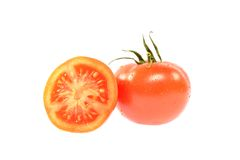 Red tomato and half Royalty Free Stock Photo