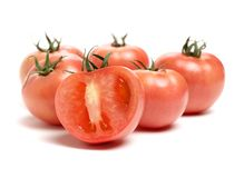 Red Tomato and Half. Isolated on the white background Royalty Free Stock Photos