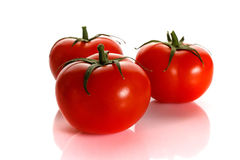 Red tomato with the handle isolated on white background Stock Photos