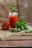 Tomato juice in a glass. Red tomato juice in a glass Royalty Free Stock Photo
