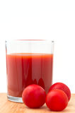 Red tomato and juice Stock Images