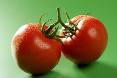 Red tomato macro over green background Stock Image