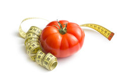 Red tomato and measuring tape Stock Photography