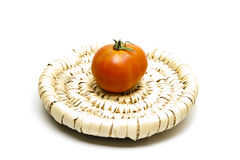 Red tomato on phloem plate. And on white background Stock Photography