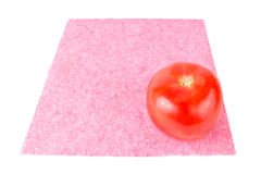 Red tomato on a pink napkin Stock Image