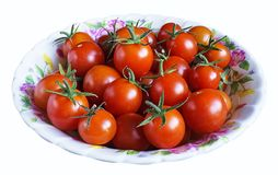 Red tomato in plate. Red tomatoes on plate insulated on white background Royalty Free Stock Images
