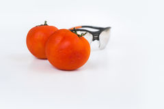 Red tomato and protection Glasses Goggle. On white background Stock Photos