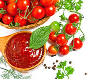 Red tomato sauce. In a wooden spoon and ingredients, isolated in white, top view Royalty Free Stock Photography