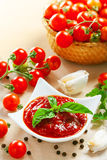 Red tomato sauce. In a pan and ingredients Stock Photo