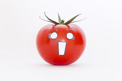 Red tomato with scared face Stock Photos