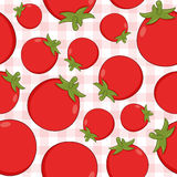 Red Tomato Seamless Pattern on Tablecloth. A seamless pattern with red tomatoes on a checkered picnic tablecloth background. Useful also as design element for Royalty Free Stock Images