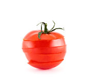 Red tomato sliced into five segments. Isolated over white background Royalty Free Stock Photo