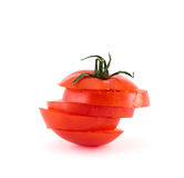 Red tomato sliced into five segments. Isolated over white background Stock Images
