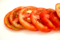 Red tomato sliced on white background Stock Photo