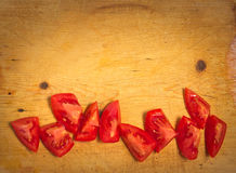 Red tomato slices on chopping board Stock Images