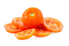 Red tomato and slices in a white background Stock Photos