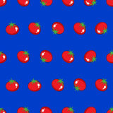 Red tomato stock  seamless pattern on blue background Royalty Free Stock Photos