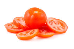 Red tomato and tomato slices on a white background Royalty Free Stock Image