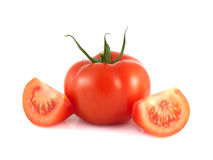 red tomato with two slices on a white. Background (fresh). Healthy vegetable Stock Image