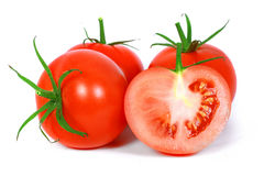 Red tomato vegetable with cut Stock Images