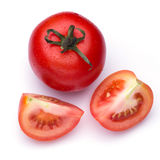 Red tomato vegetable with cut isolated on white Royalty Free Stock Image