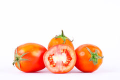 Red tomato is a vegetable that is a major component in making tomato sauce on the white background  Stock Photos