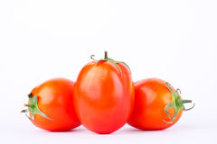 Red tomato is a vegetable that is a major component in making tomato sauce on the white background isolated Stock Photography