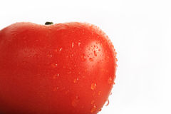 Red tomato with water drops Royalty Free Stock Image