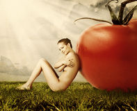 Red tomato and woman outdoor Stock Images
