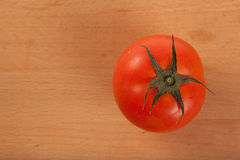 Red tomato on wooden background Royalty Free Stock Image