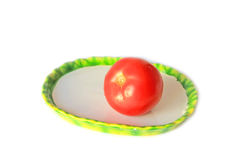 Red tomatoe on the plate Stock Image