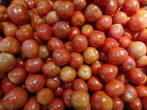 Red Tomatoes​ in market. Fresh tomato for sales Stock Photo