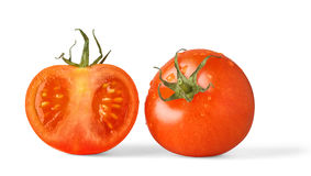 Red tomatoes. One red tomato and a half over white background royalty free stock photography