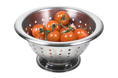 Red tomatoes. With water droplets in a colander against white background Royalty Free Stock Photo