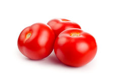 Red tomatoes. Isolated on white background stock photo