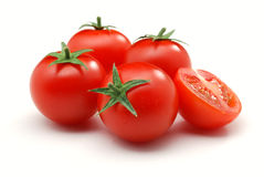 Red tomatoes. Close up of red tomatoes isolated over white Royalty Free Stock Photo