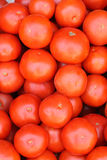 Red tomatoes background. Red tomatoes arranged at the market stand Stock Photo
