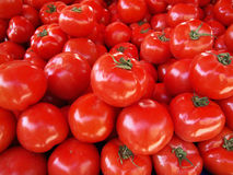 Red Tomatoes background. A background of red ripe tomatoes stock image