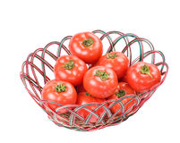 Red tomatoes in bamboo basket Stock Photos
