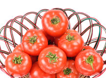 Red tomatoes in bamboo basket Stock Image
