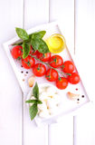 Red tomatoes, basil and mozzarella. Cheese Stock Photos