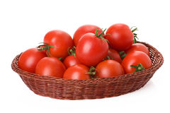 Red tomatoes in basket Royalty Free Stock Photo