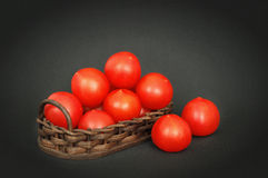 Red tomatoes in a basket Stock Images