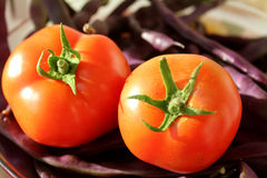 Red tomatoes and blue haricots Royalty Free Stock Photo