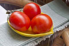 Red tomatoes. Tomatoes in a bowl on the table Stock Photos